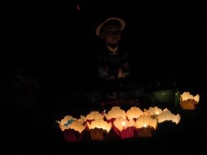 Vendedor de velas para colocar no rio